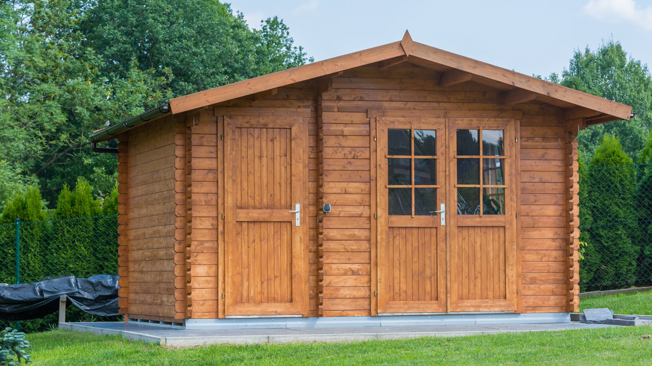 brown garden shed with windows and door